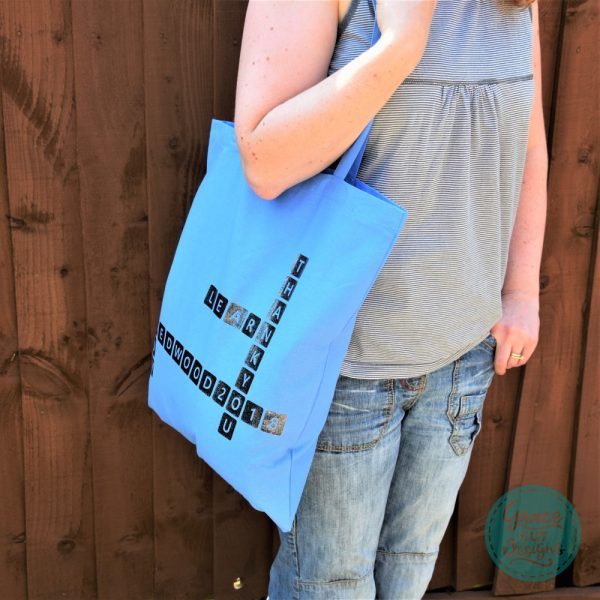 Black on Light Blue Crossword Tote Bags
