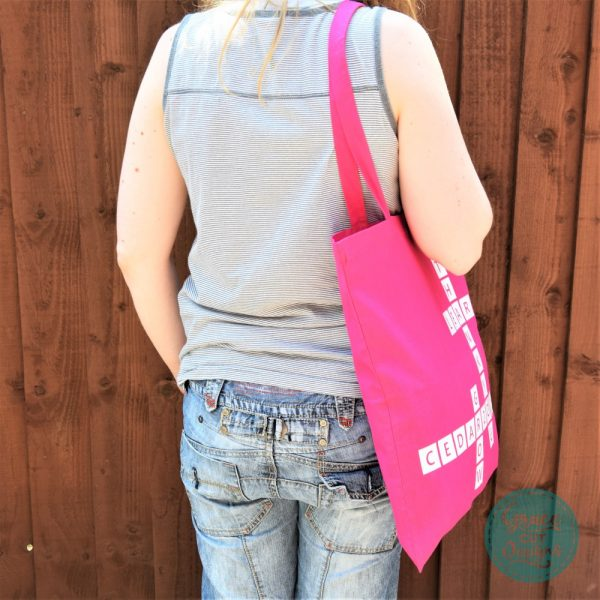 White on Pink Crossword Tote Bags